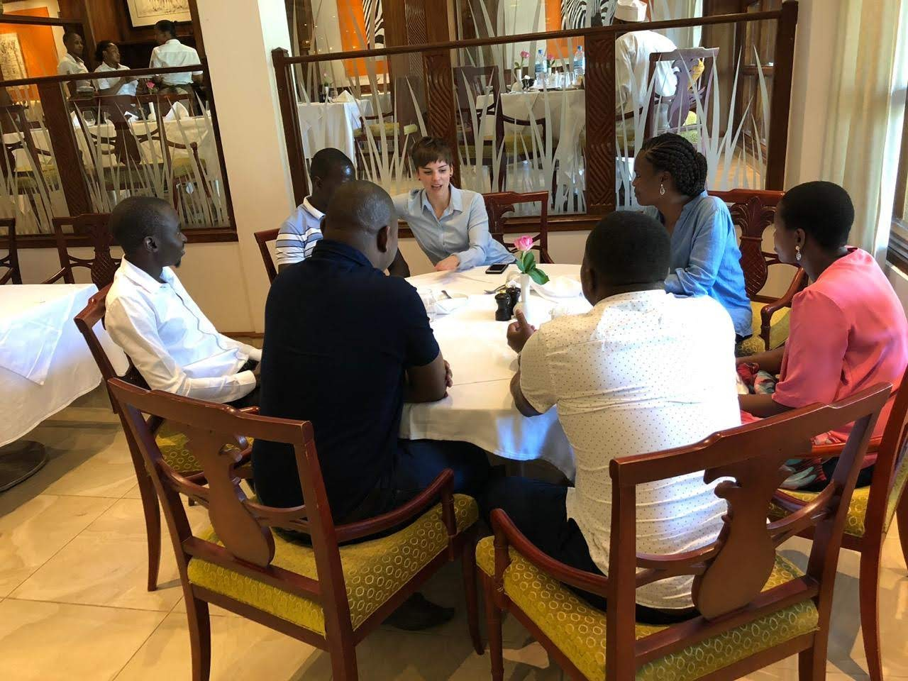 Photo of Andi Thomas meeting with people in Tanzania