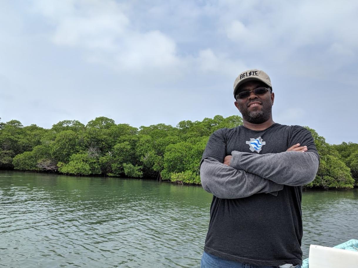photo Emil Cherrington in Belize in front of mangrove trees