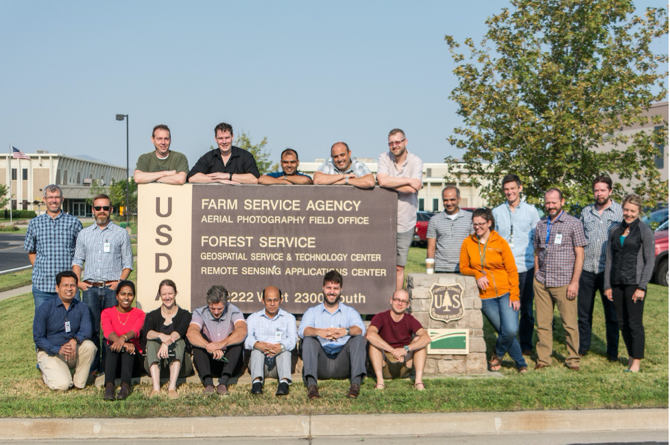 Team in front of USDA sign
