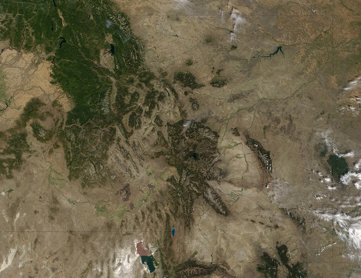 Clear skies over Montana and Wyoming reveal smoke from forest fires burning in the region.