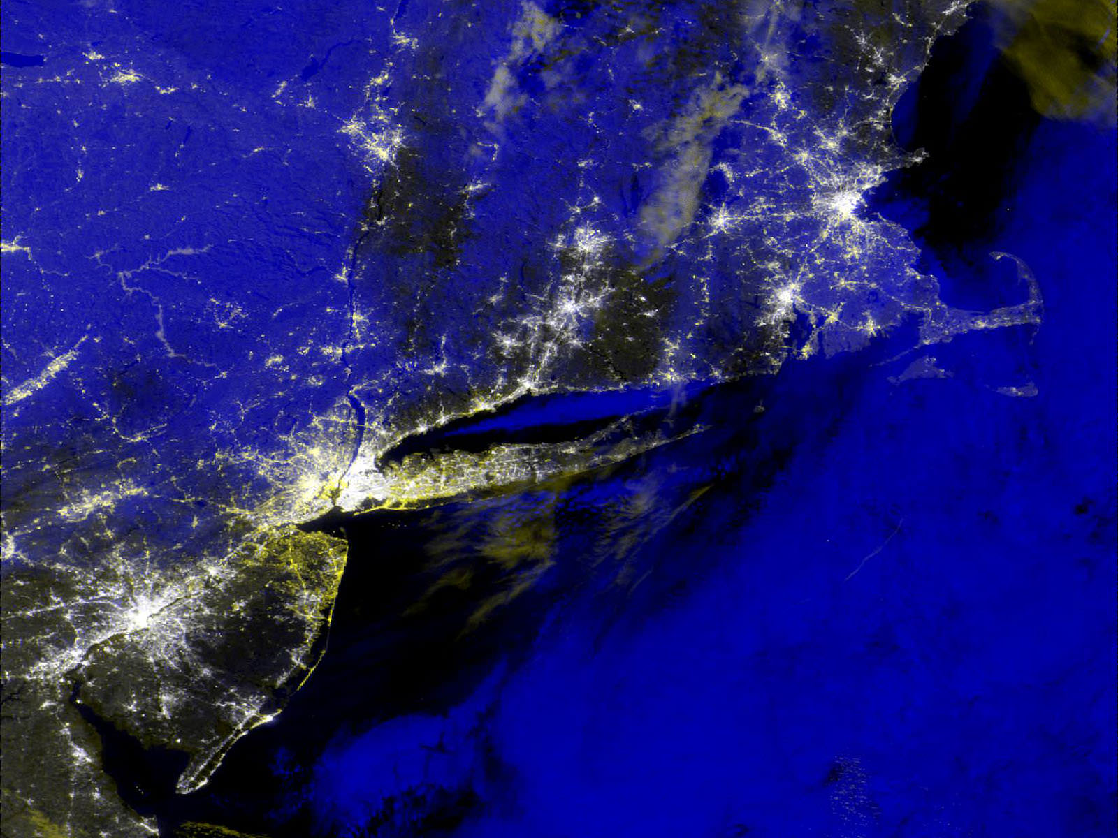 An early-morning view of New Jersey on November 1, 2012. The white areas are city lights, but the yellow spots aren't – they're outages highlighted for responders