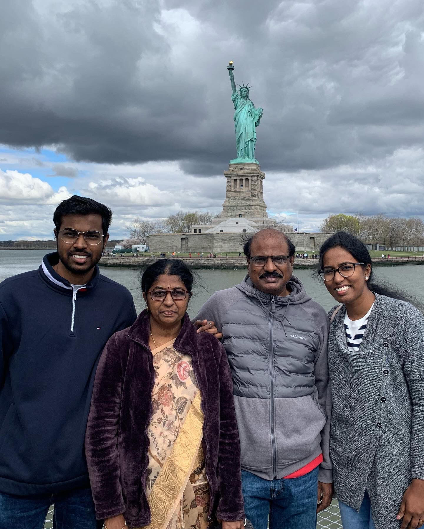Family in front of Statue of Liberty