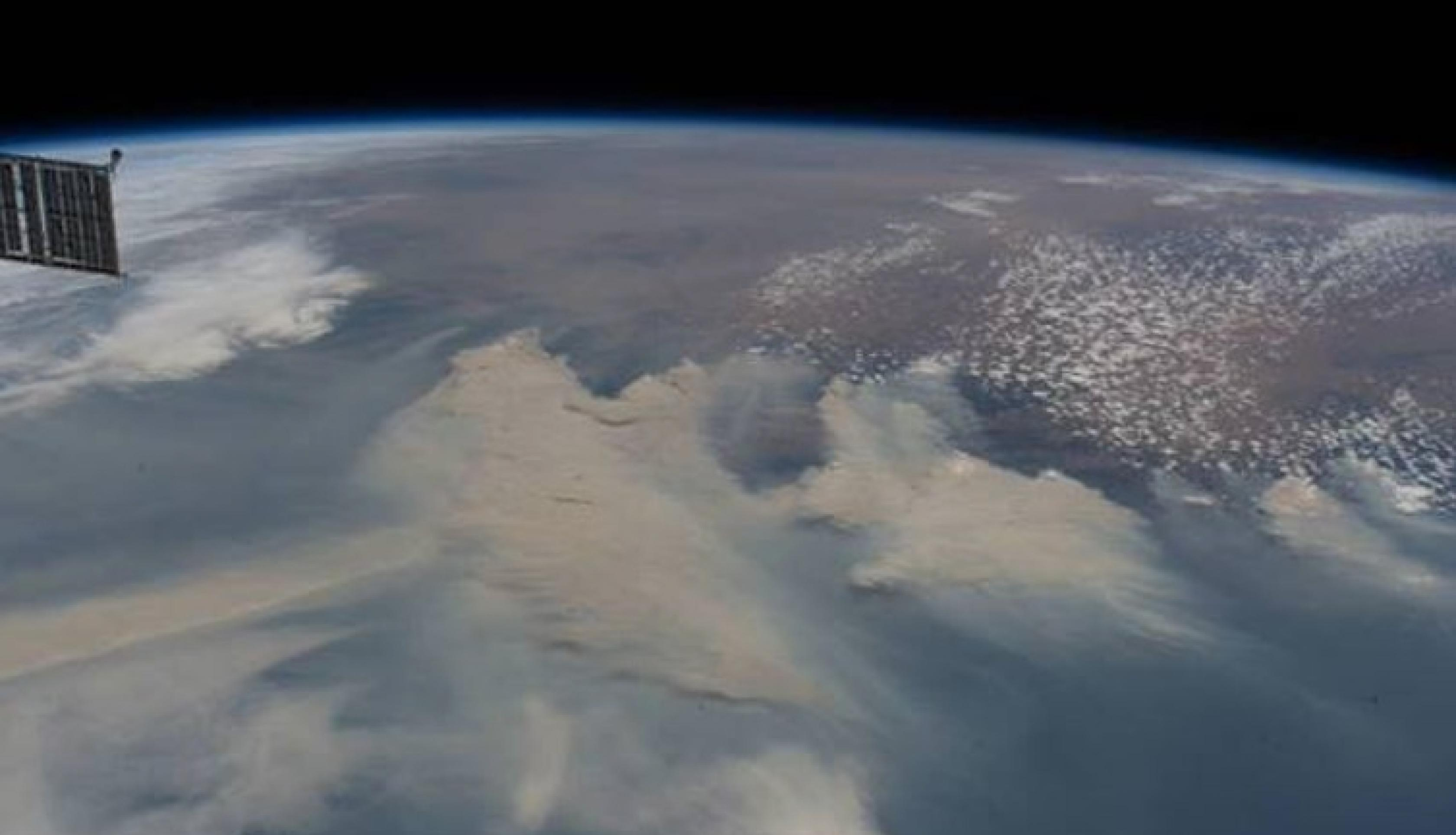Photograph of smoke rising from fires on the east coast of Australia, taken by ISS astronauts on January 4th, 2020. Credit: NASA Crew Earth Observations (CEO)