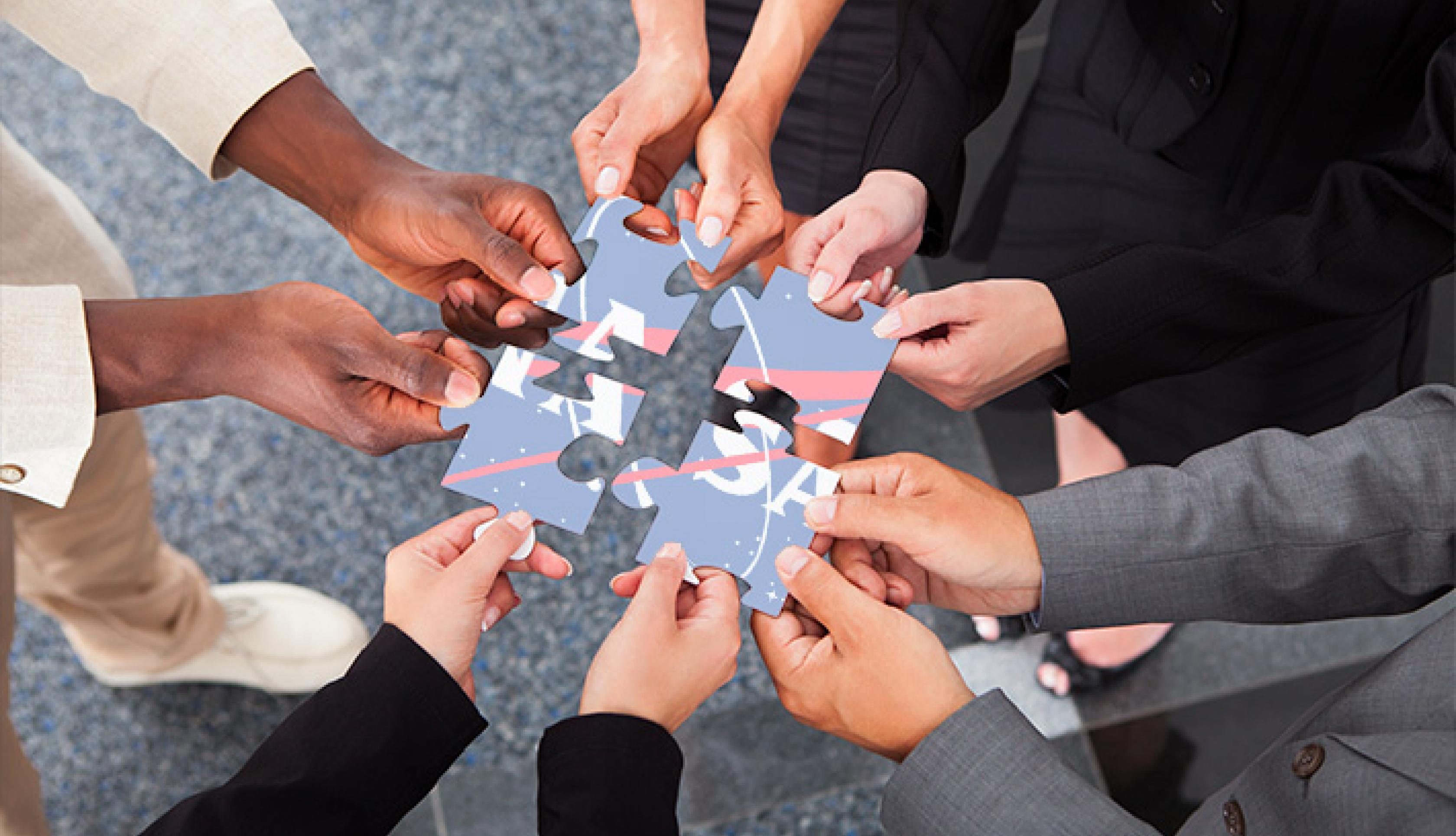 Photo of human hands holding a puzzle piece