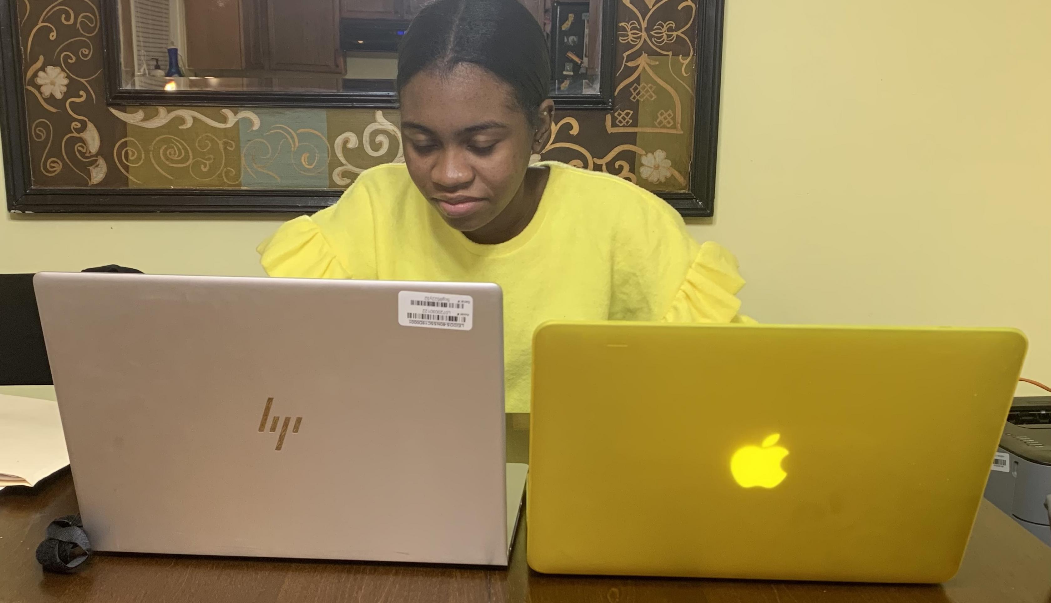Woman with two laptops