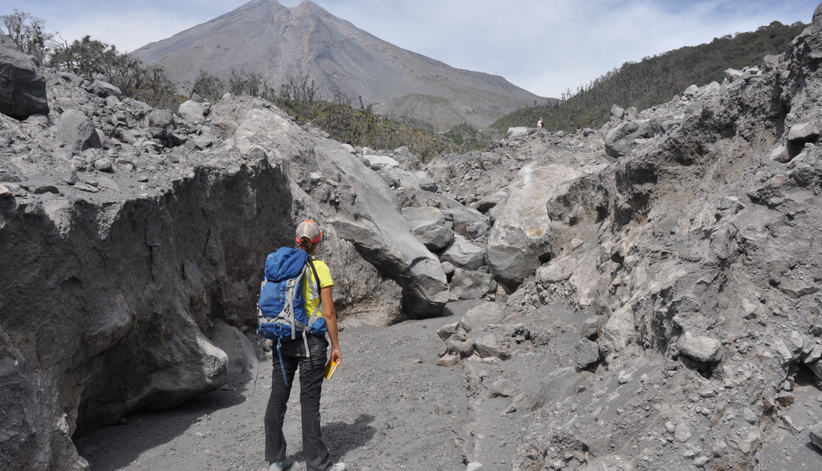 Macorps walks toward the Colima Volcano in Mexico while conducting fieldwork for her Ph.D. in 2016. Credits: Elodie Macorps