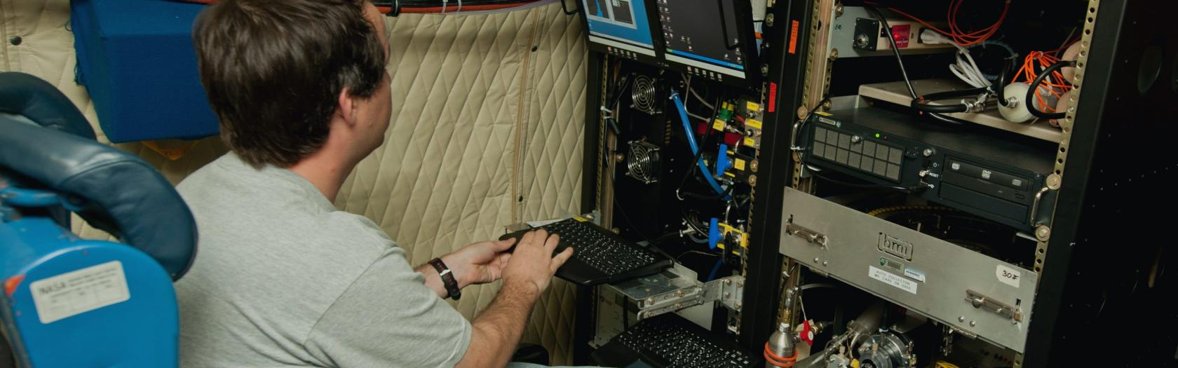 An unidentified researcher works aboard the P-3B NASA research aircraft at Baltimore/Washington International Thurgood Marshall Airport,