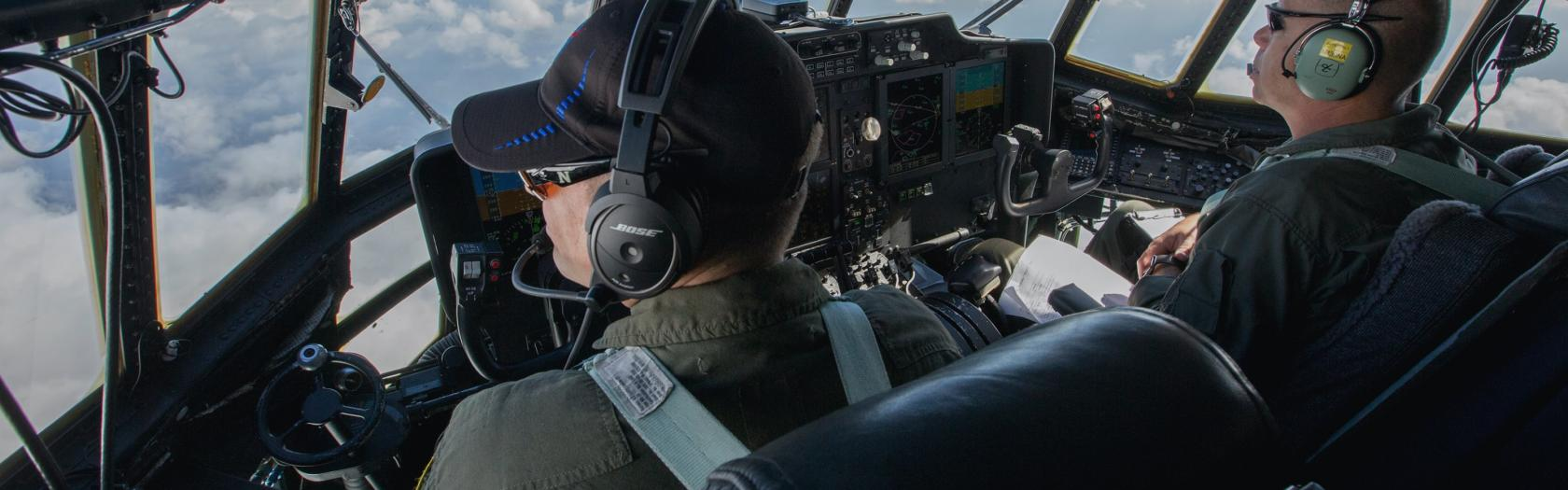 C-130 pilots Jim Lawson, left, and Paul Pinaud during a flight.