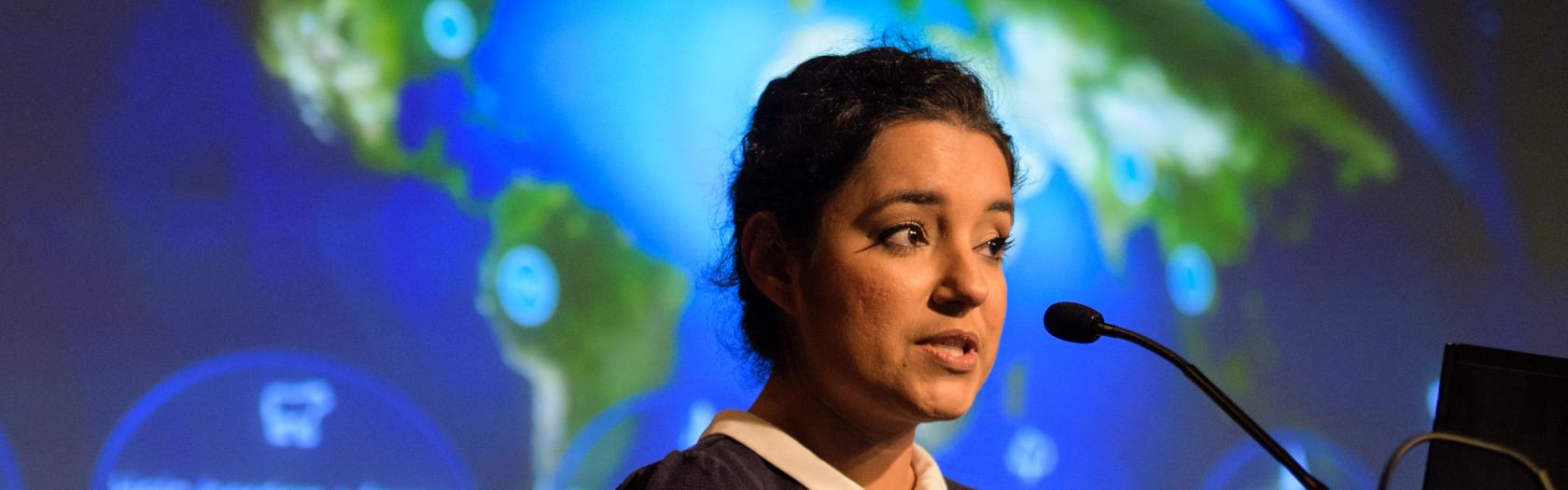 Africa Flores, Land Cover and Land Use Change Theme Lead for SERVIR, speaks during the 2018 Annual Earth Science Applications Showcase