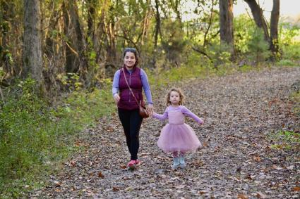 woman and child walking on a trail