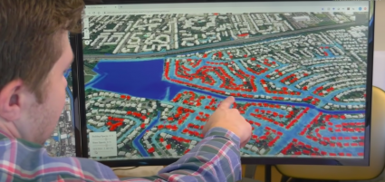 Researcher Derek Loftis showing computer model of houses affected by frequent flooding.