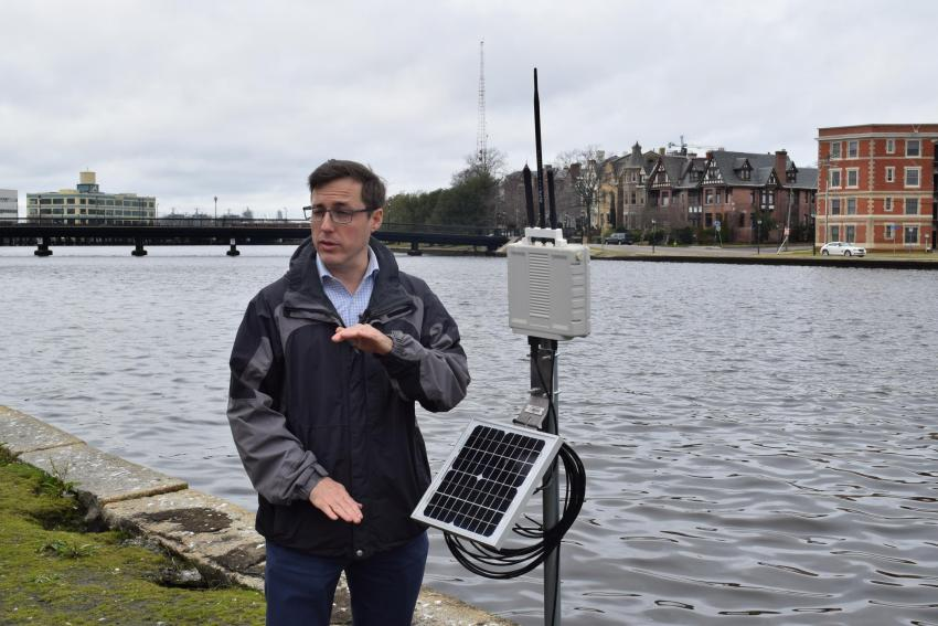 Kyle Spencer shows off a water sensor on the Hague lake in Norfolk, Virginia