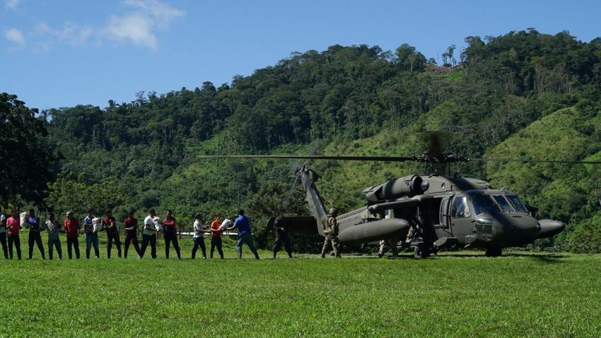 Members of an isolated community in eastern Honduras form a line to unload humanitarian food items from a UH-60 Black Hawk assigned to the 1-228th Aviation Regiment, Joint Task Force-Bravo, Nov. 28, 2020. JTF-B conducted aerial operations in Central America in response to Hurricanes Eta and Iota. Credit: U.S. Air Force/Tech. Sgt. Chris Drzazgowski