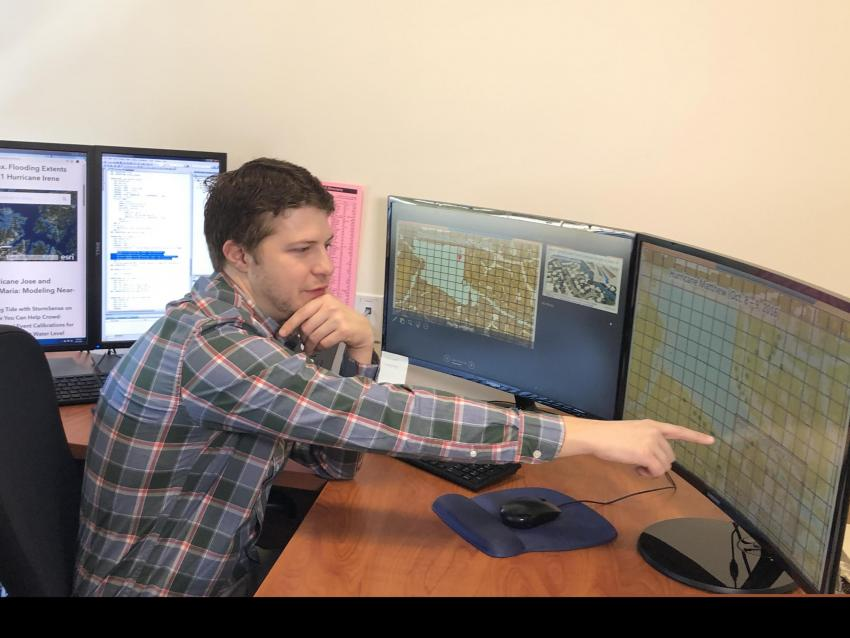 Derek Loftis pointing out how NASA's Earth-observing data is included into the flooding website.