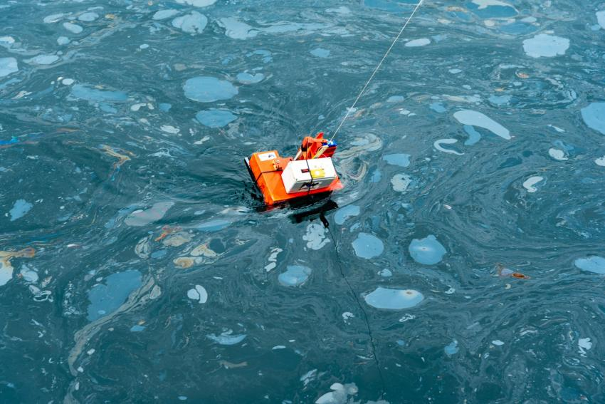 An oil sampler deployed from the U.S. Coast Guard Cutter Blackfin measuring oil thickness of a natural oil seep on the ocean surface near Santa Barbara, California, during a marine oil spill thickness field test on May 10, 2021. Credits: NASA/University of Maryland/Frank Monaldo