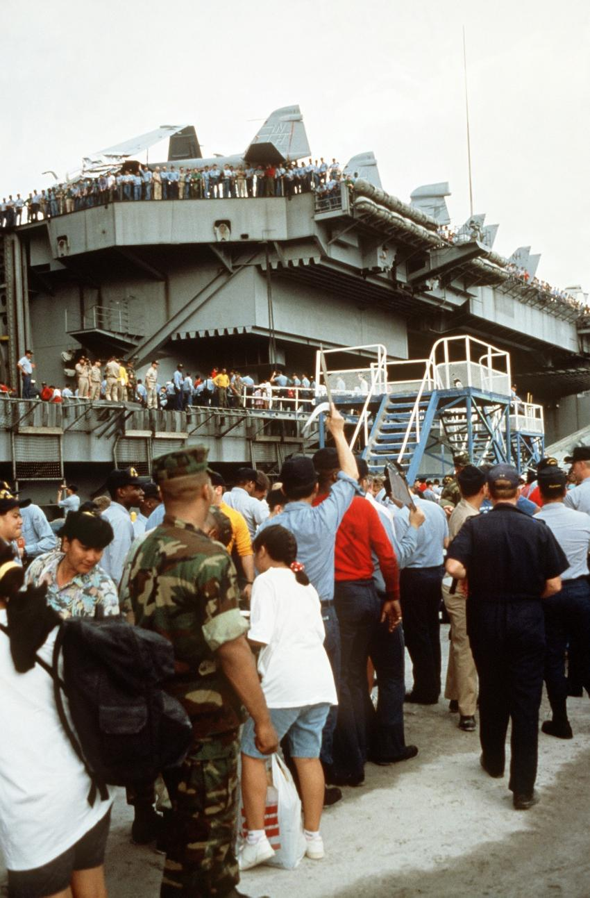 U.S. military dependents board the nuclear-powered aircraft carrier USS Abraham Lincoln (CVN-72) on June 17, 1991, as they prepare to depart in the aftermath of Mount Pinatubo's eruption. Credits: U.S. Navy/Patrick Muscott