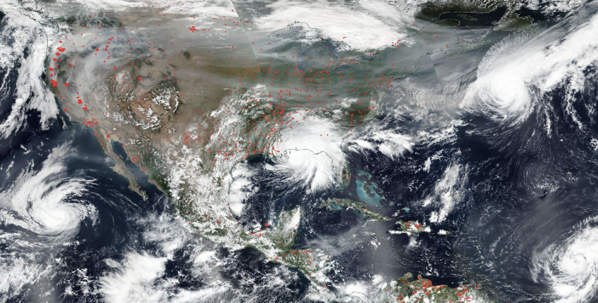 An image of the United States and Central America from September 2020, showing fires and their smoke in the west, several hurricanes converging, and Hurricane Sally making landfall. The true-color image was taken by NOAA/NASA's Suomi NPP satellite.