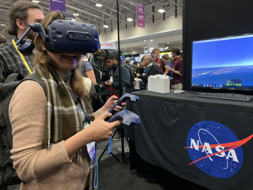An attendee of the American Geophysical Union (AGU) Fall Meeting trying out a demo of the VR disasters viewer application. Credit: Shayna Skolnik