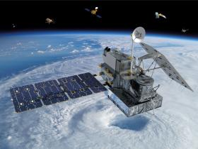 Artists rendition of the GPM satellite over a hurricane