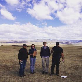 Photo of four people in field