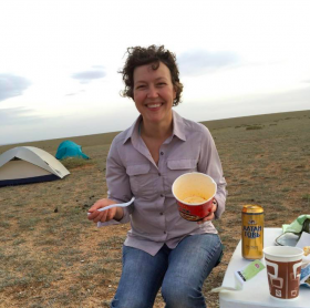 Woman eating noodles in Mongolia