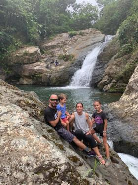 photo of family in front of waterfall