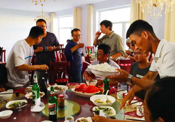 Photo of people eating Chinese food in China