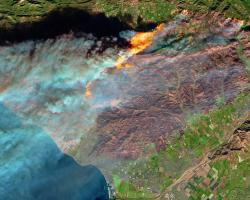 A view of an active fire and burn scar from space