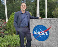 Photo of man (Ricardo Quiroga) with NASA logo