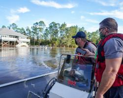 FEMA responders surveying flooded areas. Credits: FEMA